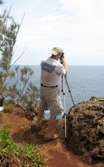 Frank taking 360 panorama on edge of cliff in Tonga
