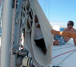 Karen inside sail to make a repair